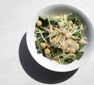 A bowl of a kale and chickpea salad.